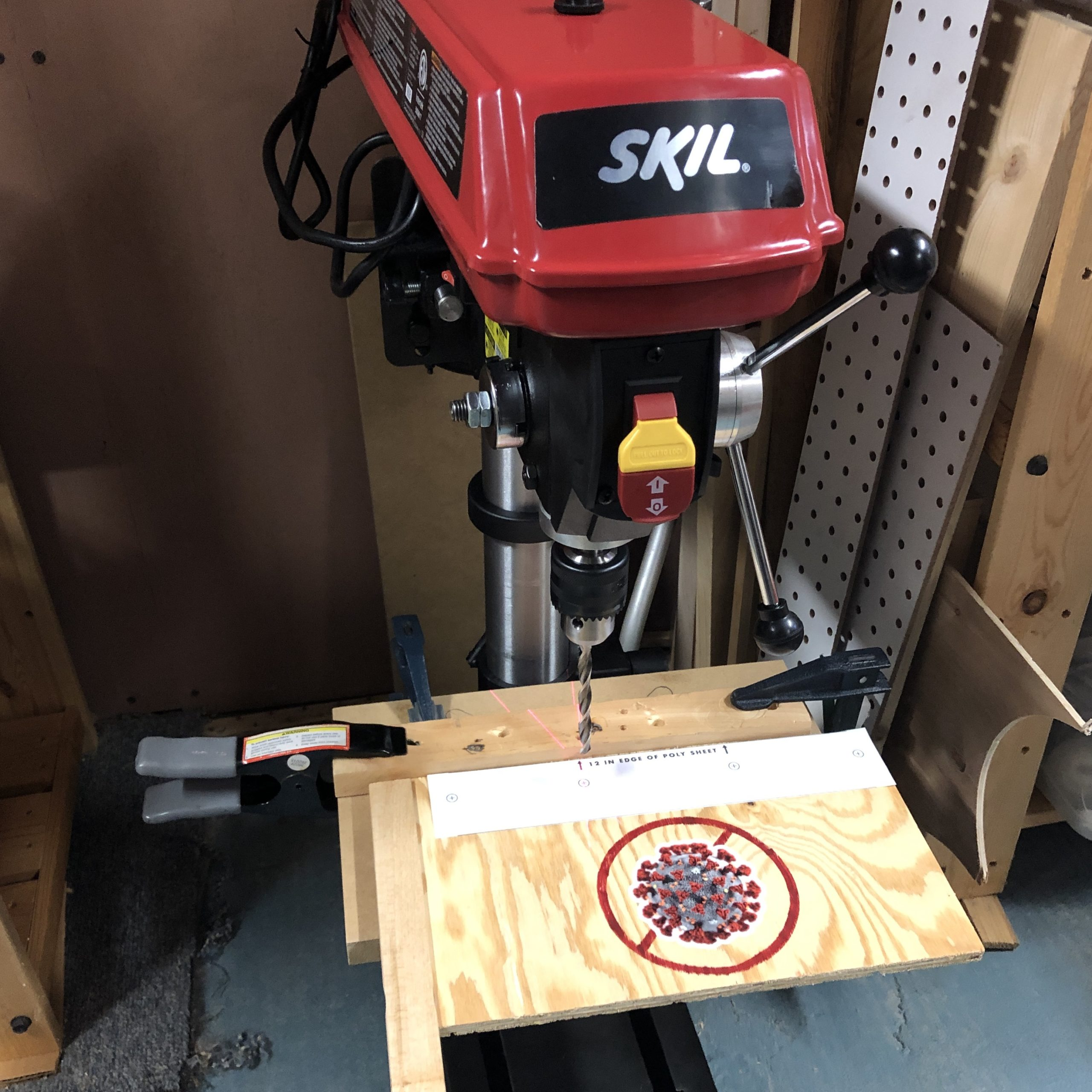 Using his drill press, Josh quickly made holes in the poly shields.