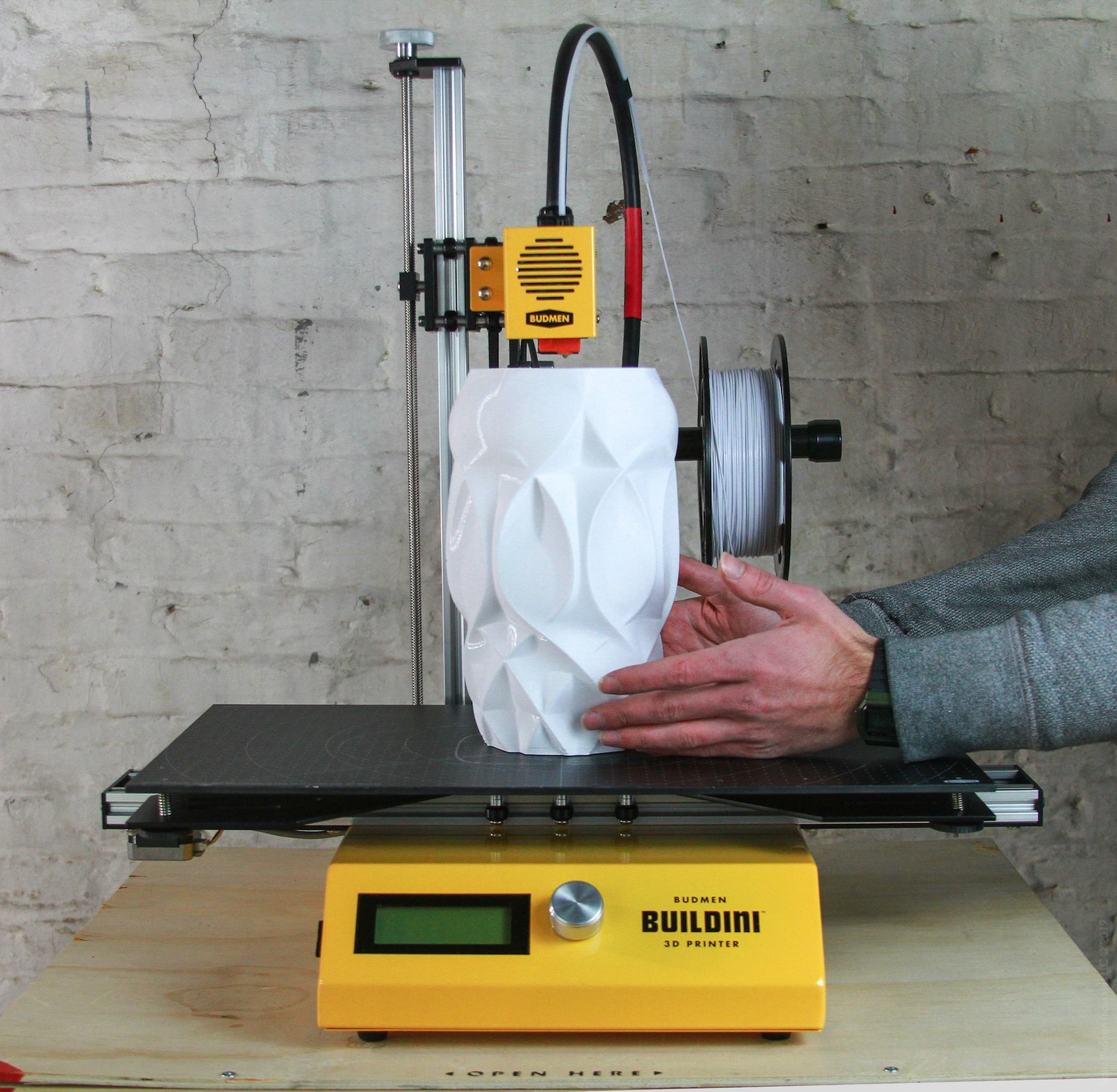 A lamp being removed from the Buildini 3D Printer